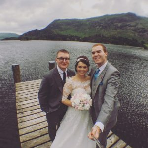 inn on the lake magician cumbria with bride and groom on jetty