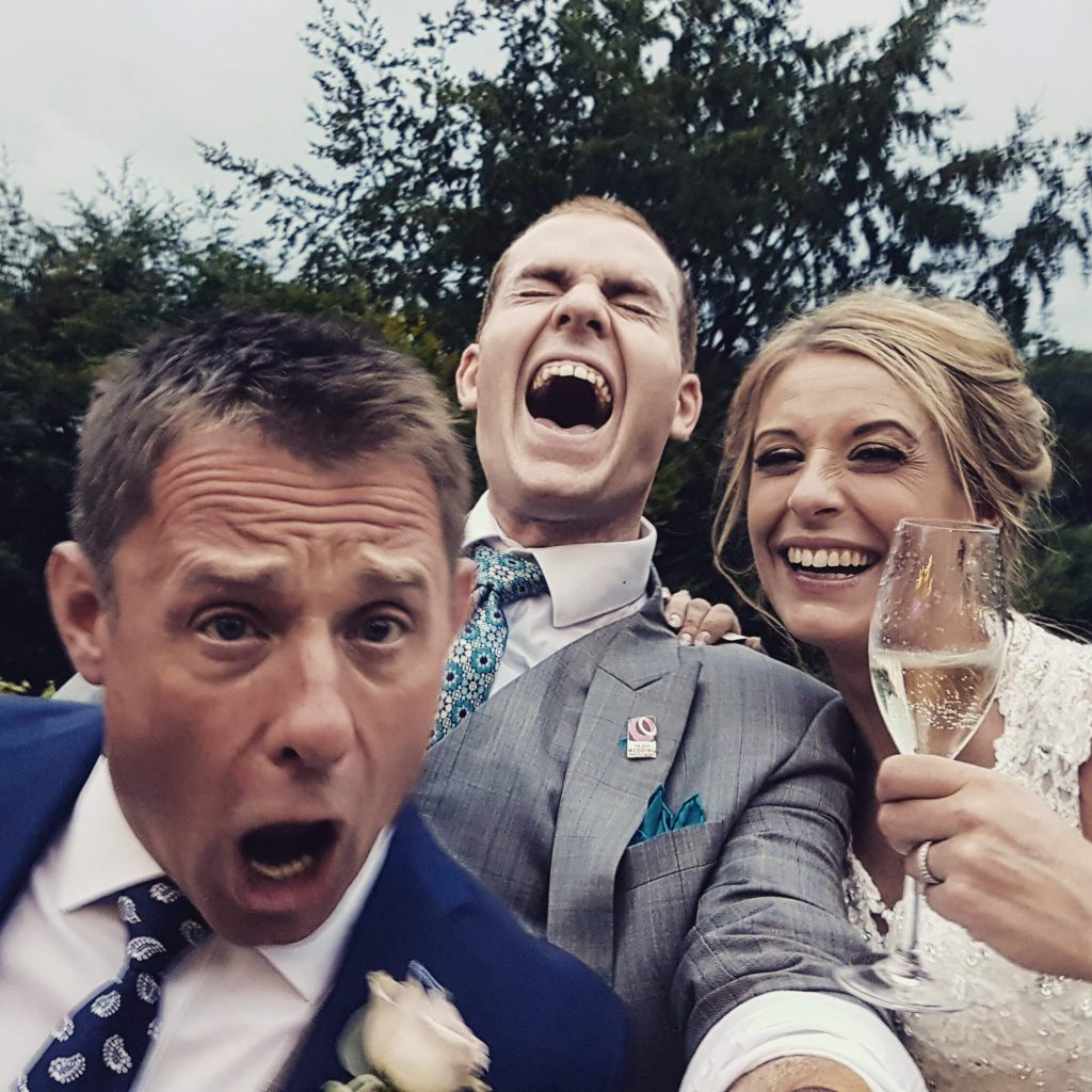 mitton hall wedding selfie with bride and groom magician