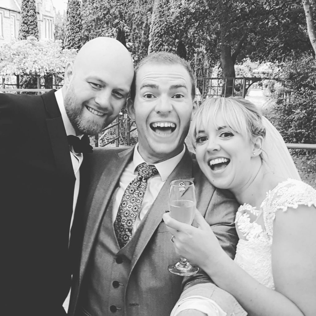 sam fitton magician with bride and groom at nunsmere hall wedding