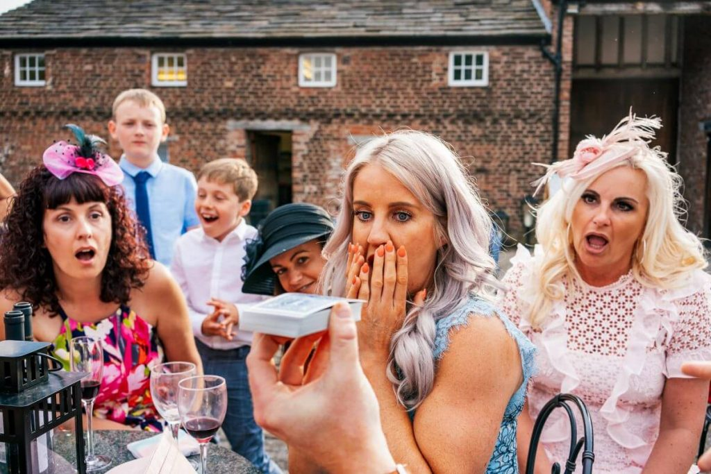 impressed wedding guests look shocked at the manchester wedding magician