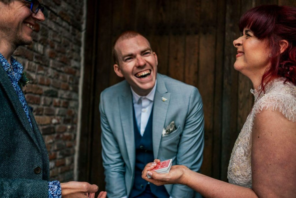 manchester wedding magician sam fitton performs for bride and groom at manchester wedding
